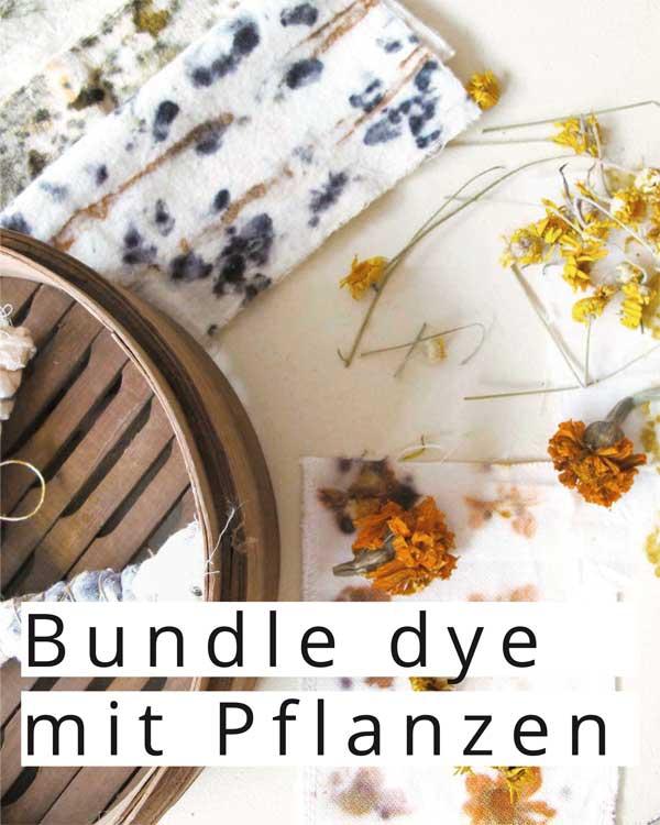 Bundle Dye: Stoffbuendel, und Stoffproben mit Mustern, getrocknete Blueten in gelb und Orange